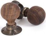Rosewood Beehive Door Knobs on Antique Brass